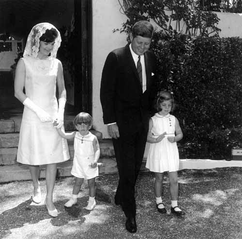 "U.S. President John F. Kennedy, his wife, Jacqueline, and their children, Caroline and John Jr., are seen on Easter Sunday in 1963. Even Kennedy's youth and ""vigah"" would be put to the test today, as he would have turned 100 years old on May 29, which happens to be Memorial Day this year. (CNS photo/Reuters)"