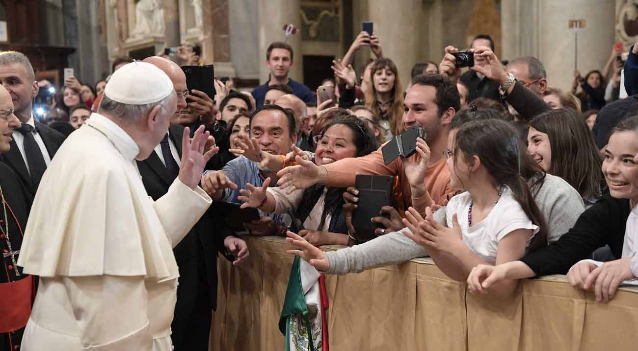 Pope Francis waves during an evening prayer vigil with young people at the Basilica of St. Mary Major in Rome April 8. (CNS photo/L'Osservatore Romano)