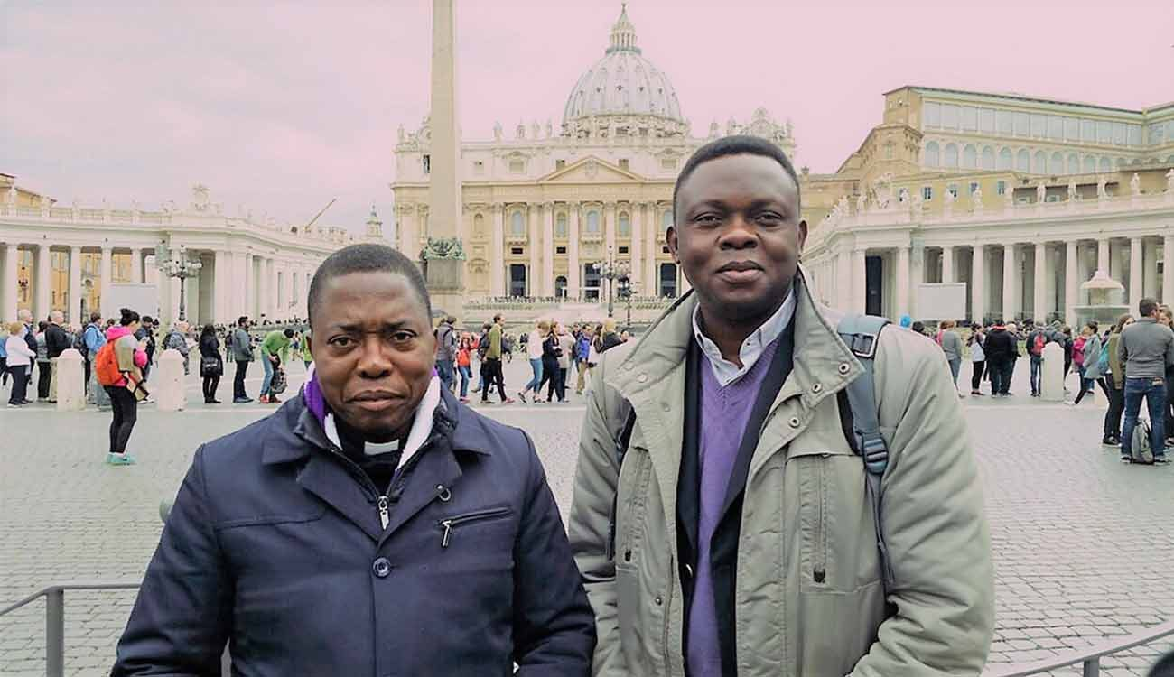 Father Richard Muembo and Father Apollinaire Cikongo are seen in Rome April 18. Global demand for metallic ores used in smartphones are thwarting efforts to end war and violence in Congo, the priests say. (CNS photo/courtesy Aid to the Church in Need)
