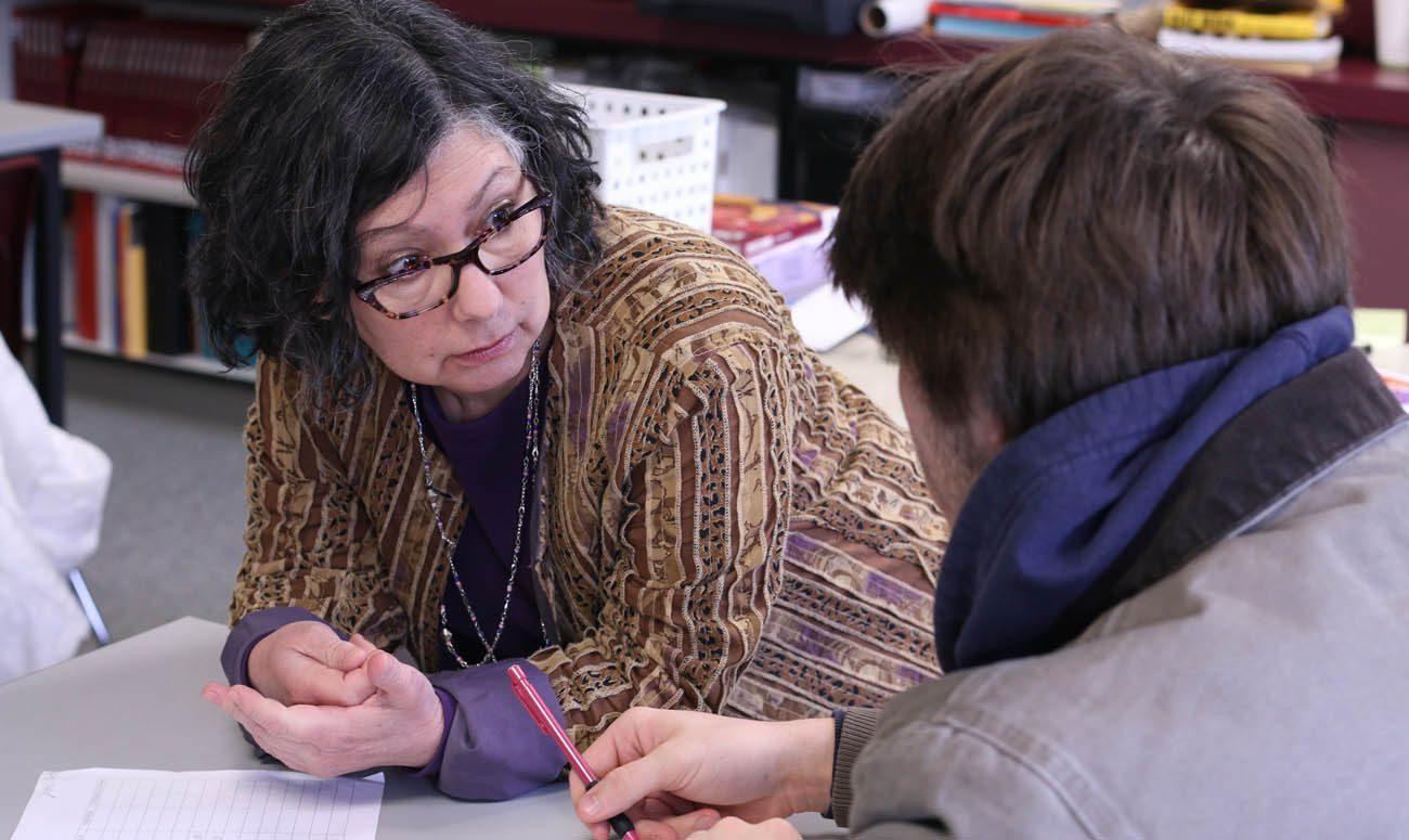 Claudia Raffaele is seen with a student at Jesuit High School in Portland Feb. 2. (CNS photo/Katie Scott, Catholic Sentinel)