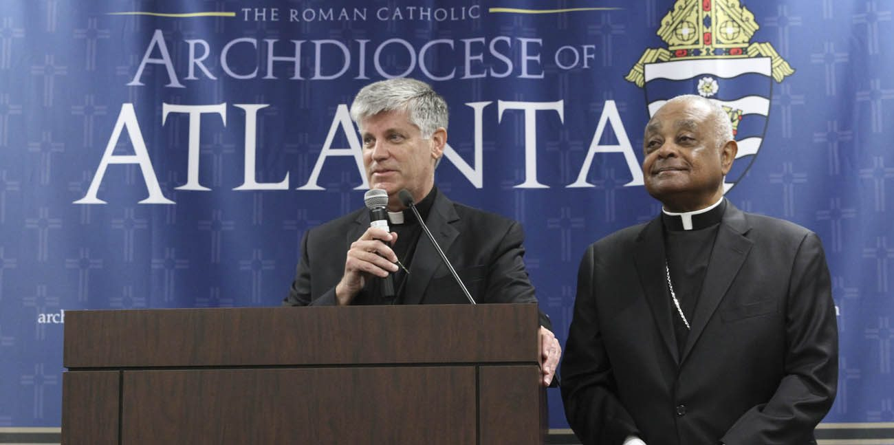 Father Bernard E. Shlesinger III, a priest of the Diocese of Raleigh, N.C., speaks alongside Atlanta Archbishop Wilton D. Gregory during a May 15 news conference after Pope Francis appointed him as an auxiliary bishop of the Archdiocese of Atlanta. Bishop-designate Shlesinger, 56, is currently the director of spiritual formation in the theology division at St. Charles Borromeo Seminary in Philadelphia. (CNS photo/Micael Alexander, Georgia Bulletin)