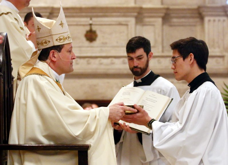 Anthony Raymundo is installed in the ministry of acolytes by Bishop John McIntyre.