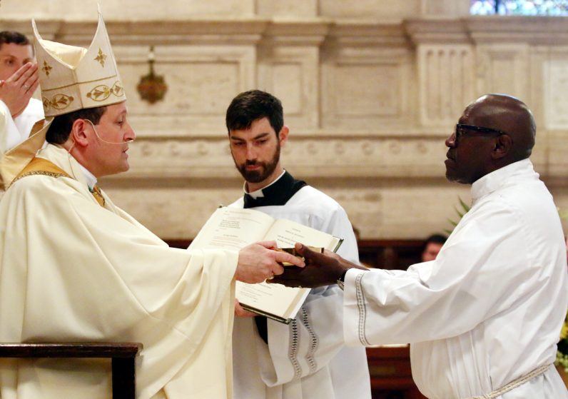 Permenant diaconate candidate Anthony Willoughby is installed to the ministy of acolytes by Bishop John McIntyre.