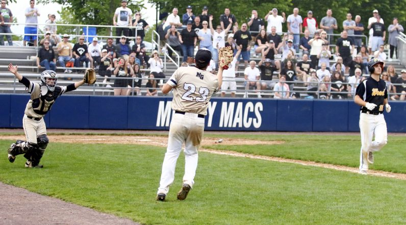 Neumann Goretti's RJ McGettigan catches a fly ball off the bat of Wood's Antonio Rossillo for the final out, sealing NG's Catholic League championship win.