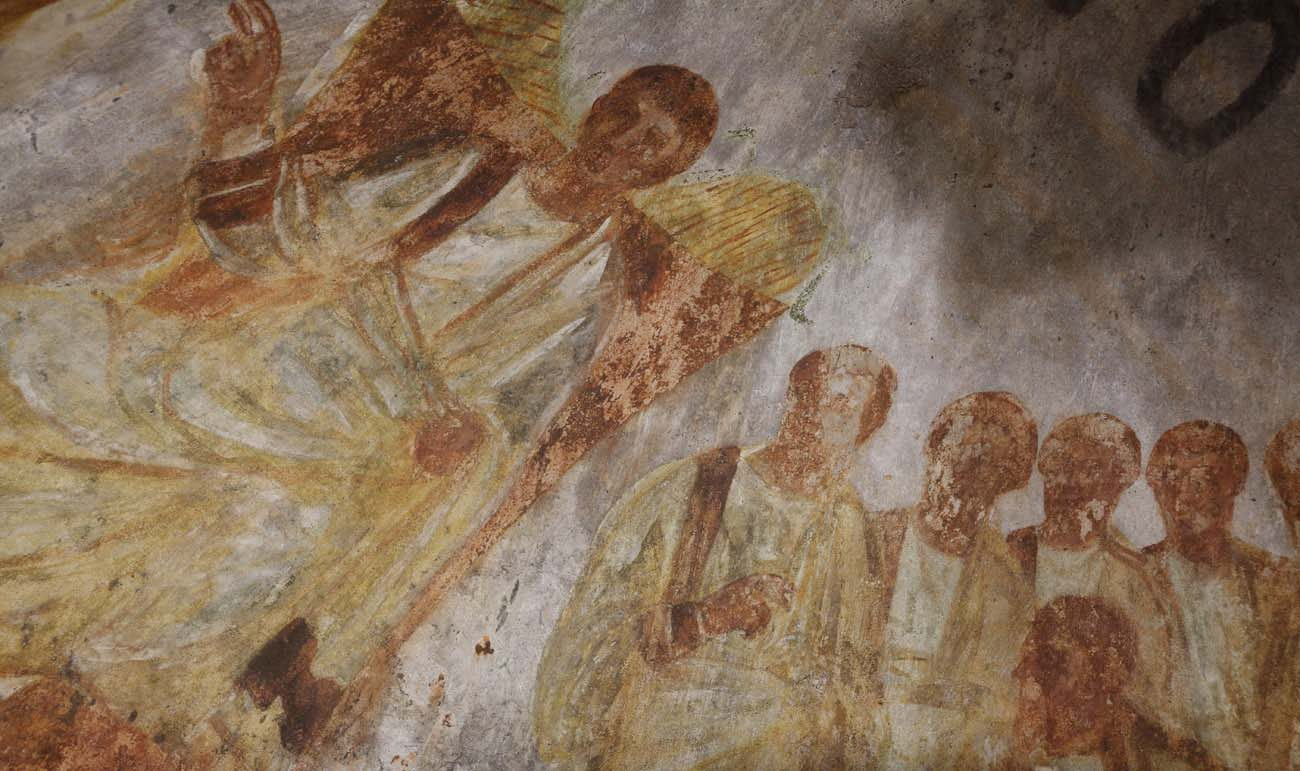 Jesus is seated on a throne with his disciples at his side in this fresco seen during the unveiling of two newly restored burial chambers in the Christian catacombs of St. Domitilla in Rome May 30. The Catacombs of St. Domitilla are believed to be the world's oldest Christian cemetery. (CNS photo/Carol Glatz)