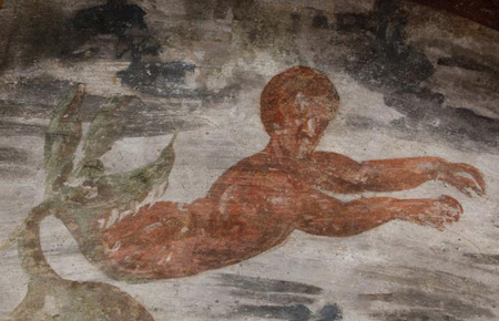 Jonah is spit out of the whale in this fresco seen during the unveiling of two newly restored burial chambers in the Christian catacombs of St. Domitilla in Rome May 30. (CNS photo/Carol Glatz)