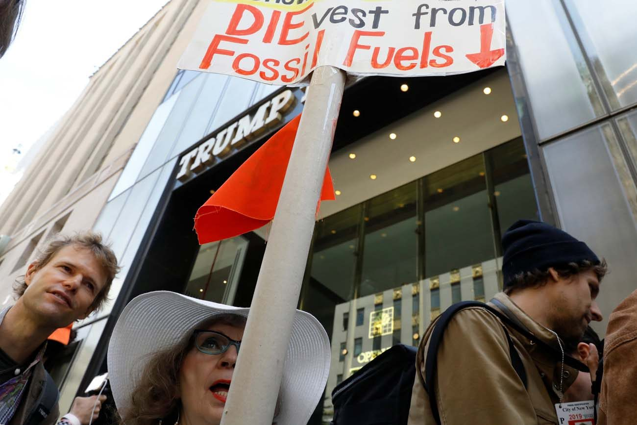 Protesters gather for a fossil fuel and climate change protest outside Trump Tower May 9 in New York City. Nine Catholic organizations, including five religious orders and an archdiocese in Italy, plan to divest from fossil fuel corporations in an action timed to send a message to the upcoming G7 summit in Italy. (CNS photo/Brendan McDermid, Reuters)