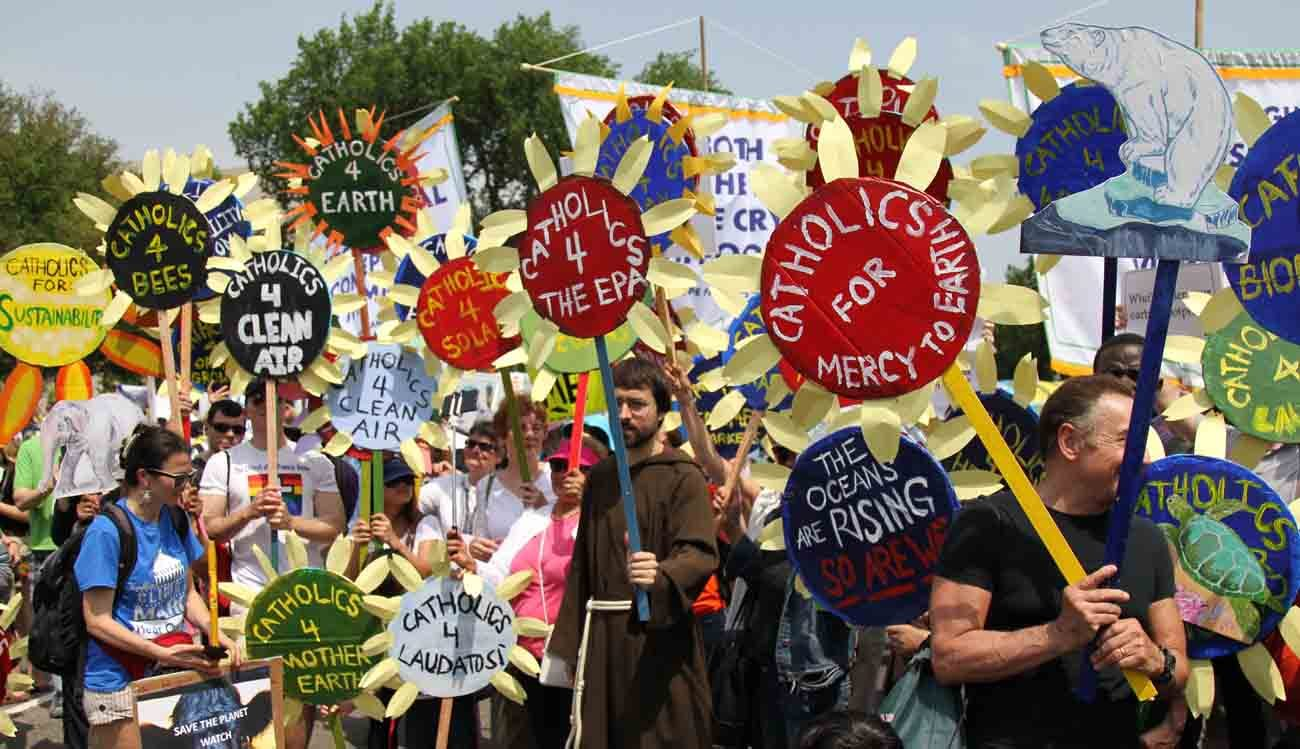 Parishioners from various parishes in New York City hold sunflower signs during the People's Climate March in Washington April 29. (CNS photo/Dennis Sadowski)