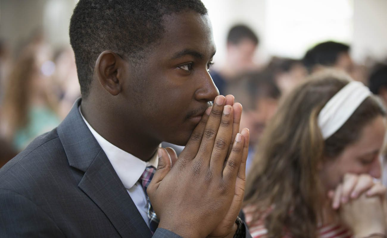 Catholic University of America student Isaiah Burroughs attends an April 30 Mass on the Washington campus at St. Vincent de Paul Chapel. Burroughs has been chosen to be one of the Archdiocese of Washington's delegates to the Convocation of Catholic Leaders being held in Orlando, Fla., July 1-4. (CNS photo/Chaz Muth)
