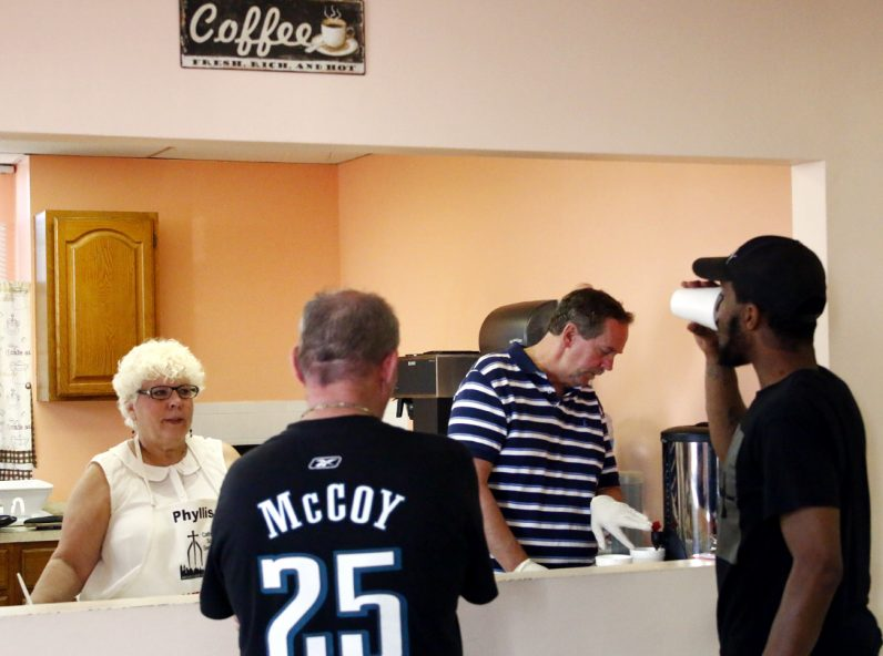 Phyllis Floyd and Chuck Fitzgerald serve coffee, danish and breakfast sandwiches at the Coffee Club in the CSS Family Service Center in Chester.