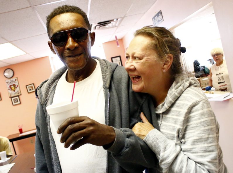 Coffee Club volunteer Kathleen Leary is happy to see Harry Taylor, a resident of Chester, during his visit to the Catholic Social Services-run program. (Sarah Webb)
