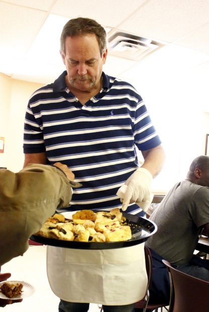 Chuck Fitzgerald circulates through the Coffee Club to make sure everyone has a second helping.