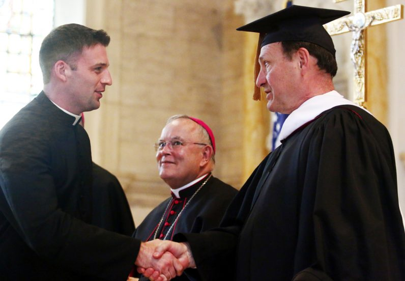 Justice Samuel Alito Jr. congratulates Deacon Kyle Adamczyk during Concursus May 17 at St. Charles Borromeo Seminary in Wynnewood.