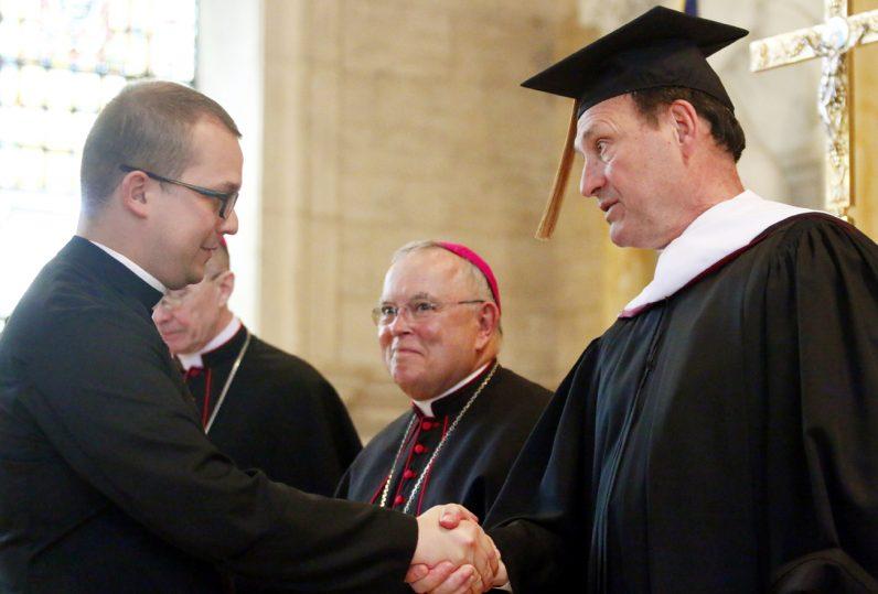 Justice Samuel Alito Jr. congratulates Deacon Patrick Muka.