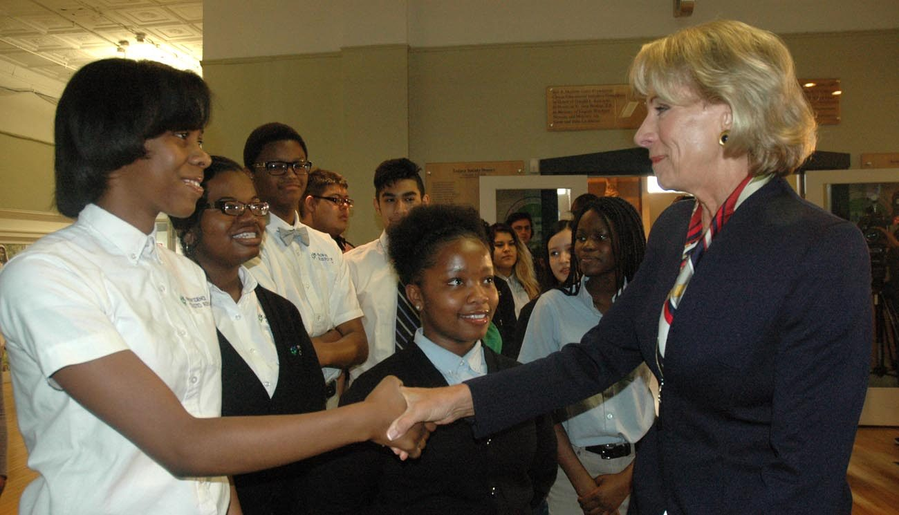 U.S. Secretary of Education Betsy DeVos shakes hands with Alexis Stratton, a freshman at Providence Cristo Rey High School in Indianapolis, during the secretary's May 23 visit to the school. (CNS photo/John Shaughnessy, The Criterion)