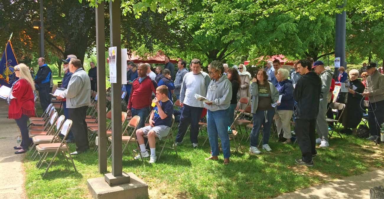 Participants from various faith traditions pray together in the 66th annual National Day of Prayer celebration May 4 in Rose Tree Park, Media, Delaware County.
