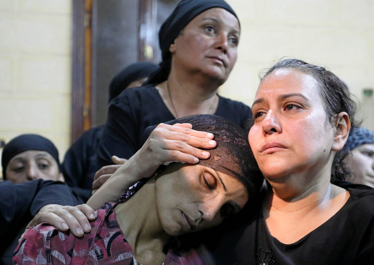 The mother of one of the victims of an attack on a group of Coptic Christians that took place May 26 attends a funeral at the Sacred Family Church in Minya, Egypt, that same day. (CNS photo/Mohamed Abd El Ghany, Reuters)