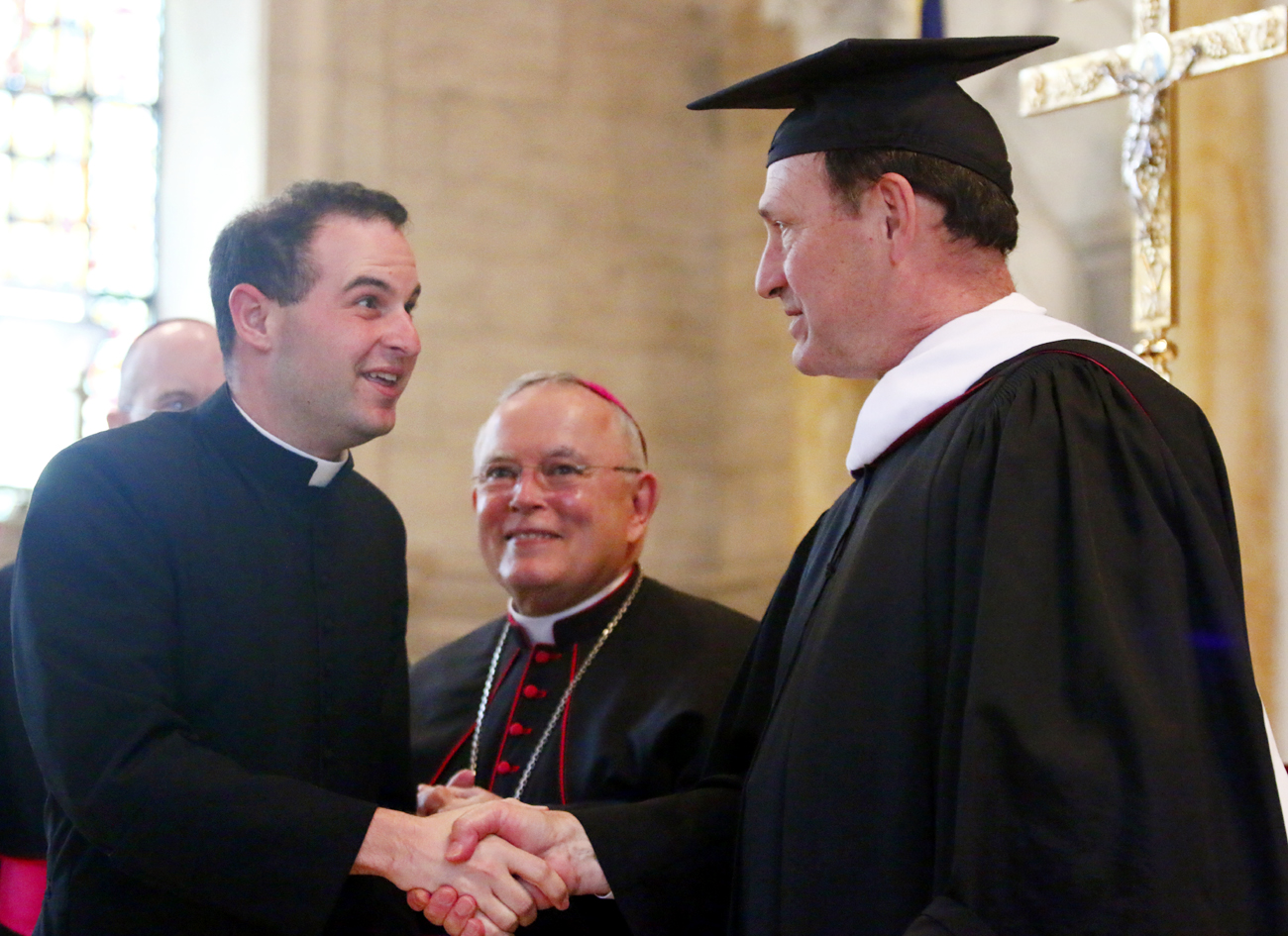 Eric Banecker is congratulated by Justice Samuel Alito, Jr. at Saint Charles Borrmeo Seminary on May 17.