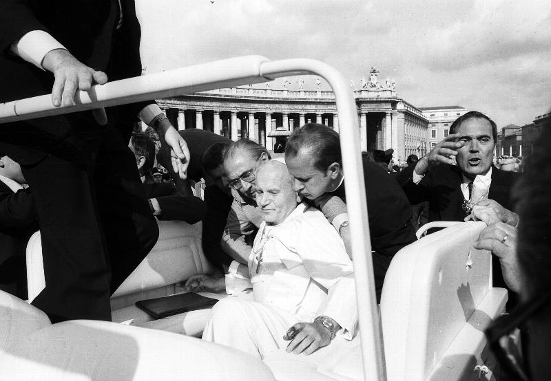 St. John Paul II is assisted by aides after being shot in St. Peter's Square May 13, 1981, as he rode in an open jeep greeting pilgrims on the feast of Our Lady of Fatima. St. John Paul credited his miraculous survival to Our Lady of Fatima, to whom he had an ardent devotion. (CNS photo/L'Osservatore Romano)