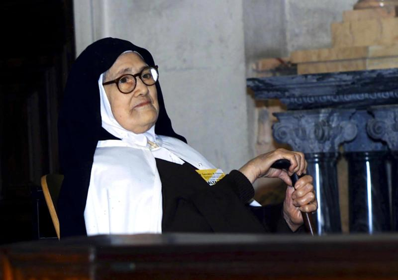 Sister Lucia dos Santos, one of the three children who saw Our Lady of Fatima in 1917 and who lived in the Carmelite convent of St. Teresa in Coimbra, Portugal, until her death in 2005 at 97, is pictured in this 2000 file photo. In 2008, Pope Benedict XVI lifted the normal five-year waiting period to begin the canonization process of Sister Lucia. (CNS photo/Paulo Carrico, EPA)