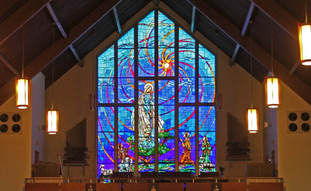 An image of Our Lady of Fatima appearing to the three children in 1917 in Portugal is shown in a stained glass window at Our Lady of Fatima Church, Secane, Delaware County.