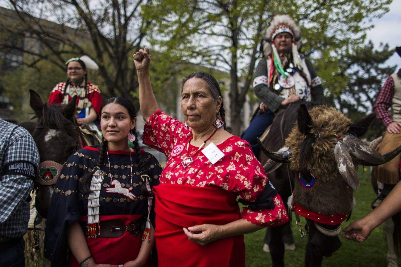 Samantha Jones of the Sicangu Lakota band of the Rosebud Sioux, left, and Casey Camp of the Ponca Nation are seen in Washington in this 2014 file photo. The Jesuits are returning more than 500 acres in South Dakota to the Rosebud Sioux. (CNS photo/Jim Lo Scalzo, EPA)