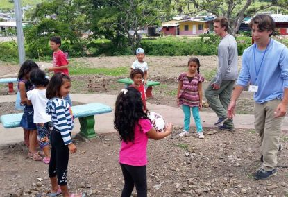 George and Luke Celentano of St. Patrick Parish in Malvern play soccer with children in Holy Family Community, Nicaragua, during a trip there in 2016.