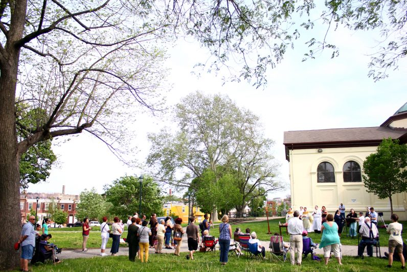 """The faithful of Mother of Mercy House and community residents celebrate Mass for all those touched by addiction. The location for the Mass was significant as McPherson Square Park is commonly known as """"needle park"""" for its reputation as a place for drug use."""