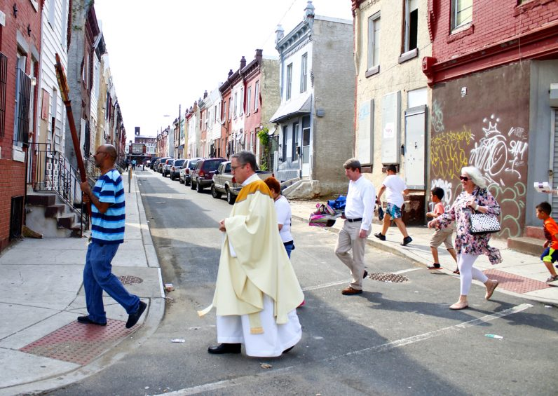 The procession winds through the streets of Kensington.