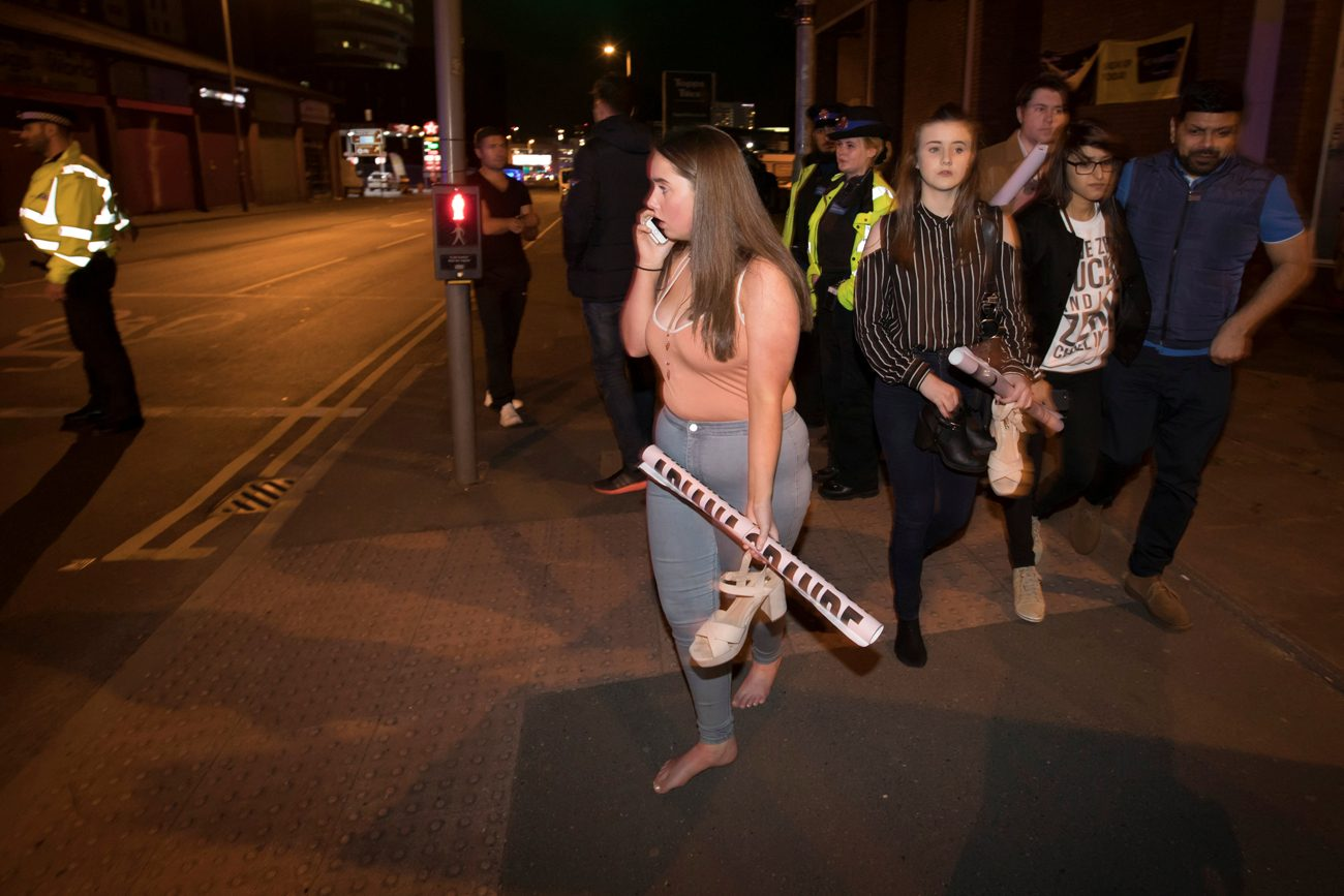 Concertgoers react after fleeing Manchester Arena in England where U.S. singer Ariana Grande had been performing May 22. At least 22 people, including children, were killed and dozens wounded after an explosion at the concert venue. Authorities said it was Britain's deadliest case of terrorism since 2005. (CNS photo/Jon Super, Reuters)