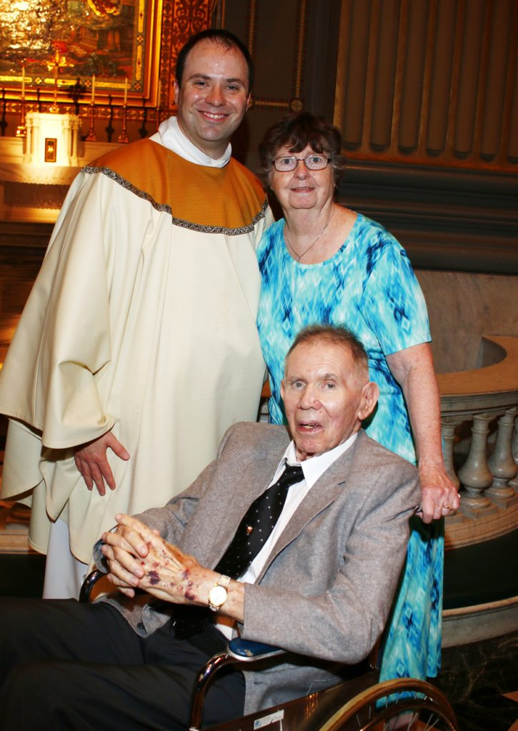 Father Brian Connolly with his parents.