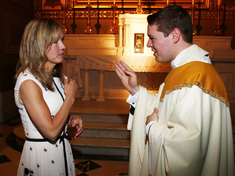 Father Matthew Brody blesses his mother for the first time since being ordained.