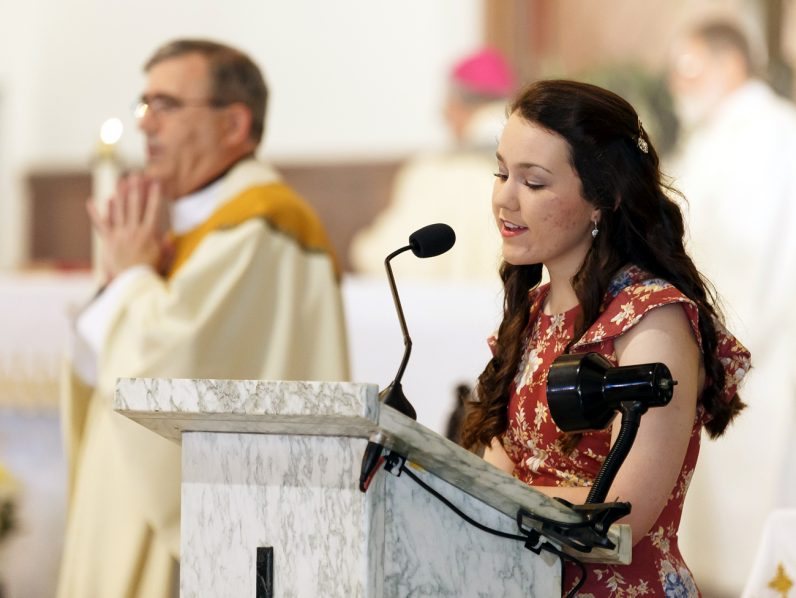Christina Dietzler leads the congregation in song as cantor for the May 14 Mass at Our Lady of Fatima in Secane.