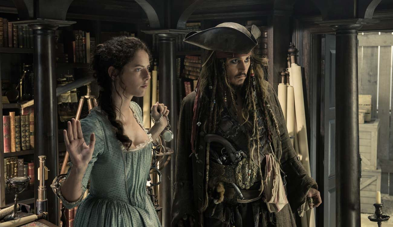 """Kaya Scodelario and Johnny Depp star in a scene from the movie """"Pirates of the Caribbean: Dead Men Tell No Tales.""""  (CNS photo/Disney)"""