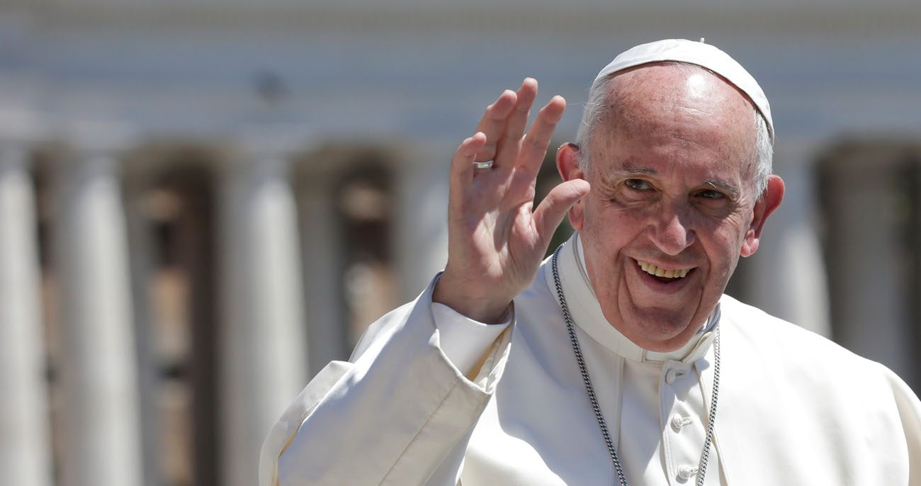 Pope Francis waves as he arrives for his general audience in St. Peter's Square May 17 at the Vatican. (CNS photo/Max Rossi, Reuters)