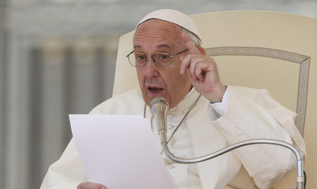 Pope Francis speaks during his general audience in St. Peter's Square at the Vatican May 31. (CNS photo/Paul Haring)