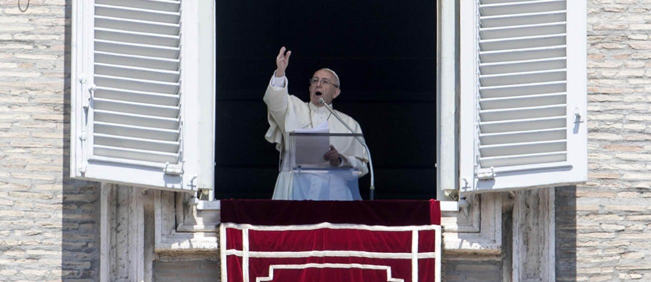 """Pope Francis leads the """"Regina Coeli"""" prayer from the window of his studio overlooking St. Peter's Square at the Vatican May 21. The pope concluded the traditional Sunday prayer by announcing that he intends to create five new cardinals at a June 28 consistory. The new cardinals are from Mali, Spain, Sweden, Laos and El Salvador. (CNS photo/Massimo Percossi, EPA)"""