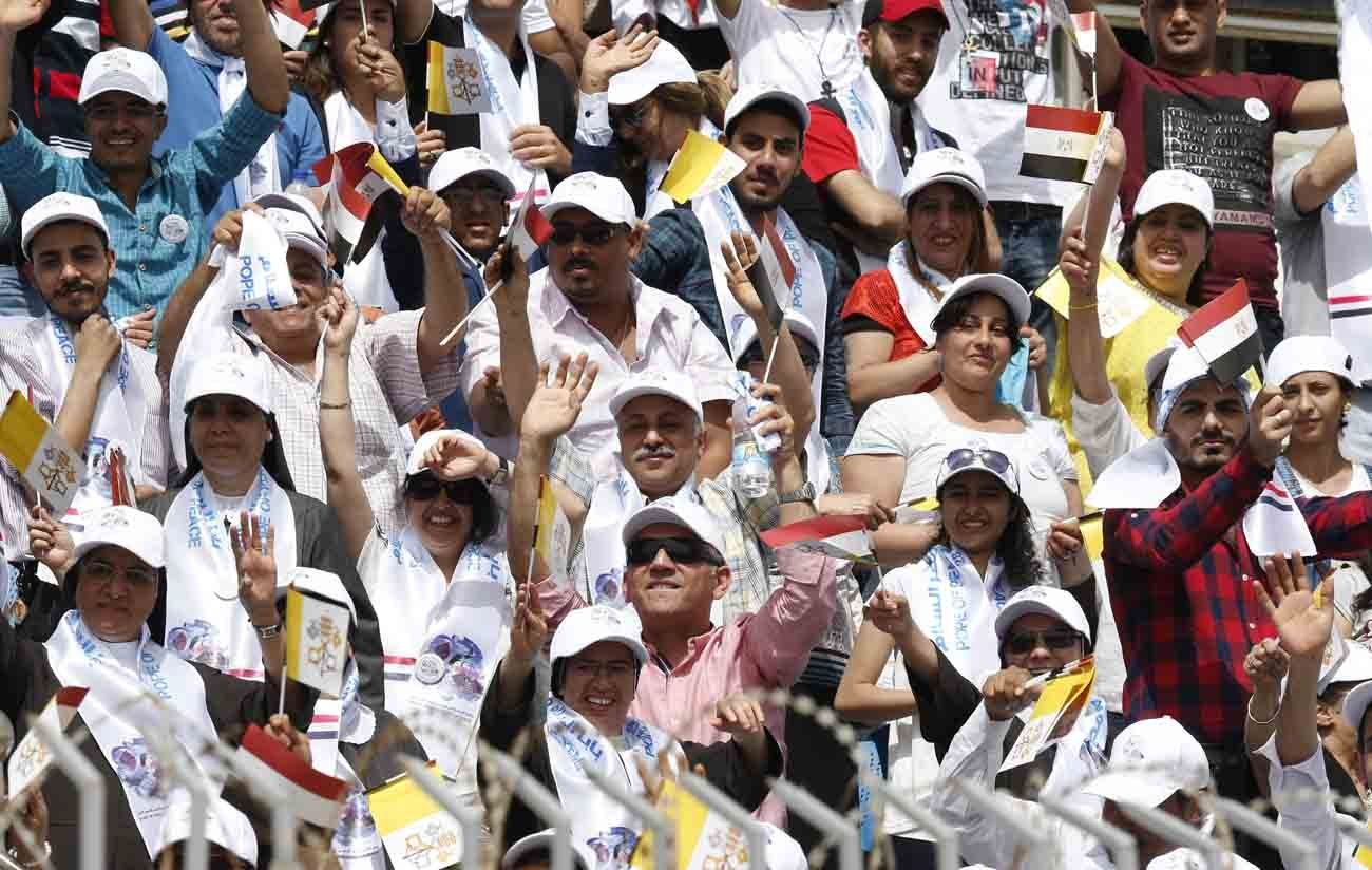 The crowd reacts as Pope Francis arrives to celebrate Mass at the Air Defense Stadium in Cairo April 29. (CNS photo/Paul Haring)