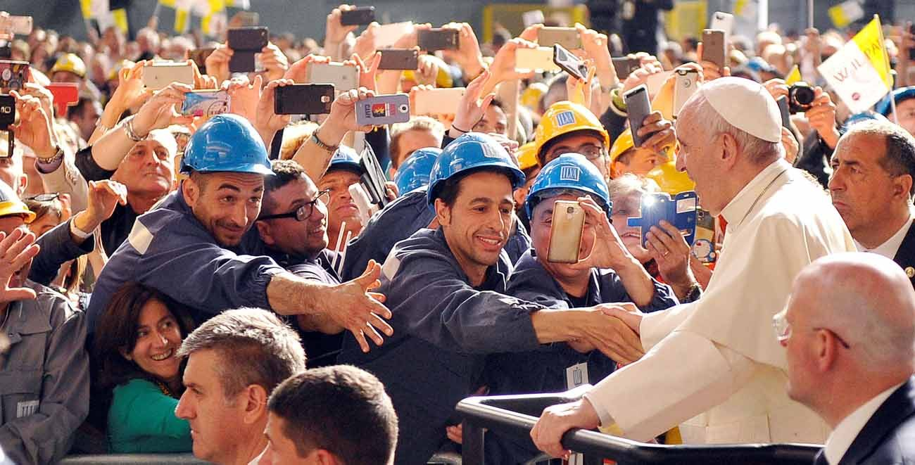 Pope Francis greets workers as he arrives at the ILVA steel plant during his May 27 pastoral visit in Genoa, Italy. (CNS photo/Giorgio Perottino, Reuters)