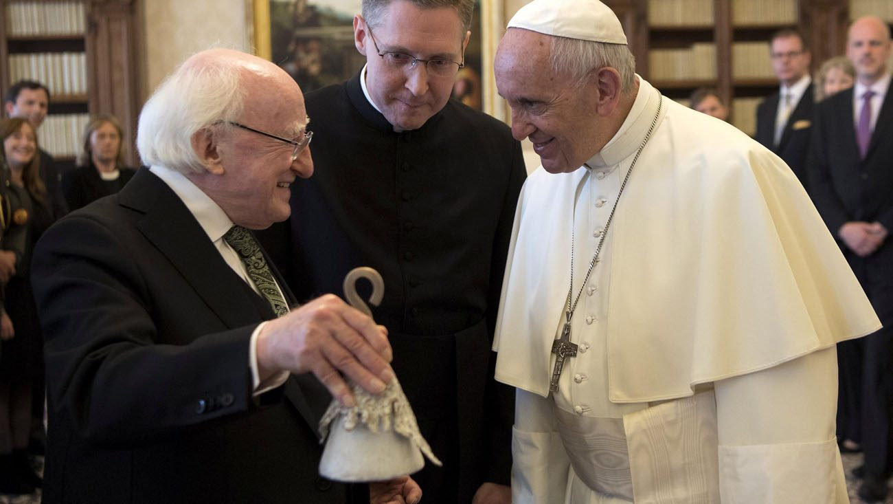 Pope Francis exchanges gifts with Irish President Michael D. Higgins during a private audience May 22 at the Vatican. (CNS photo/Maurizio Brambatti, pool via Reuters)