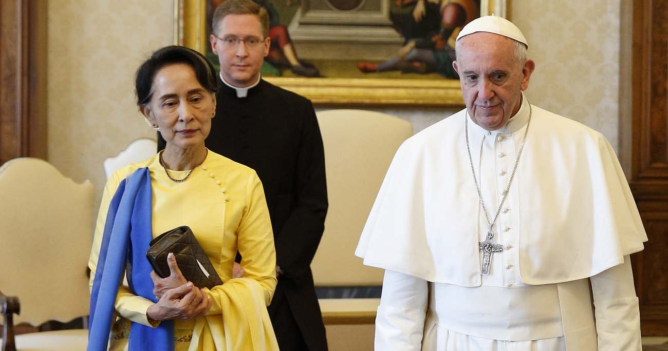 Pope Francis walks with Aung San Suu Kyi, leader of Myanmar, during a private audience at the Vatican May 4. (CNS photo/Paul Haring)