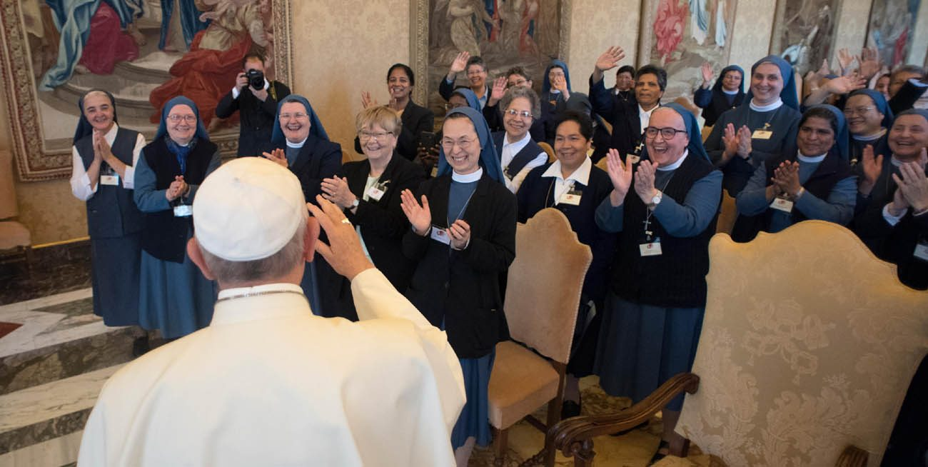 Pope Francis greets participants in the general chapter of the Sister Disciples of the Divine Master during an audience at the Vatican May 22. (CNS photo/L'Osservatore Romano)