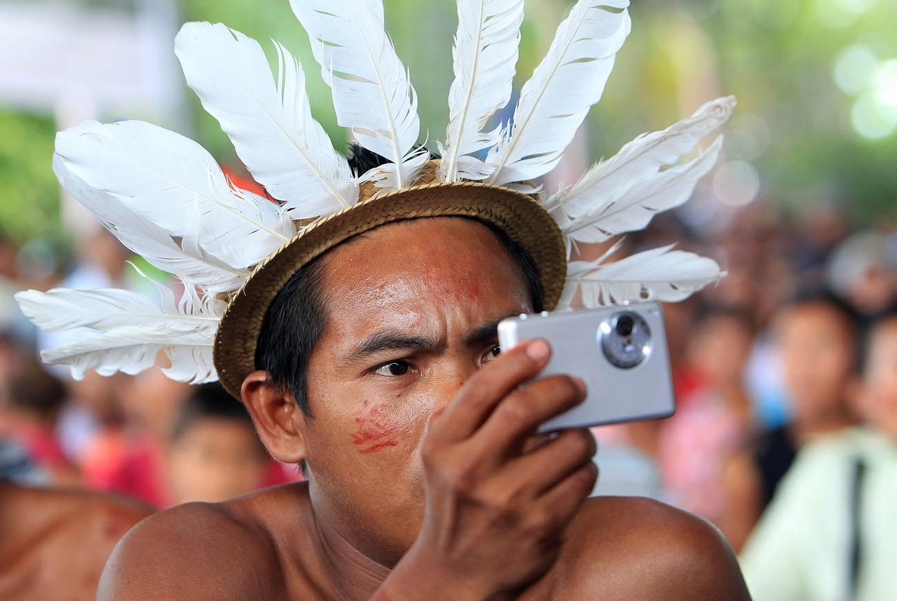 An indigenous member of the Desano ethnic group handles a camera during a meeting in Mitu, Colombia, Aug. 19, 2016. Archbishop Salvador Pineiro Garcia-Calderon of Ayacucho, president of the Peruvian bishops' conference, said May 16 that Pope Francis is considering dedicating a meeting of the Synod of Bishops to the concerns of the indigenous people of the Amazon region. (CNS photo/Mauricio Duenas Castaneda, EPA)