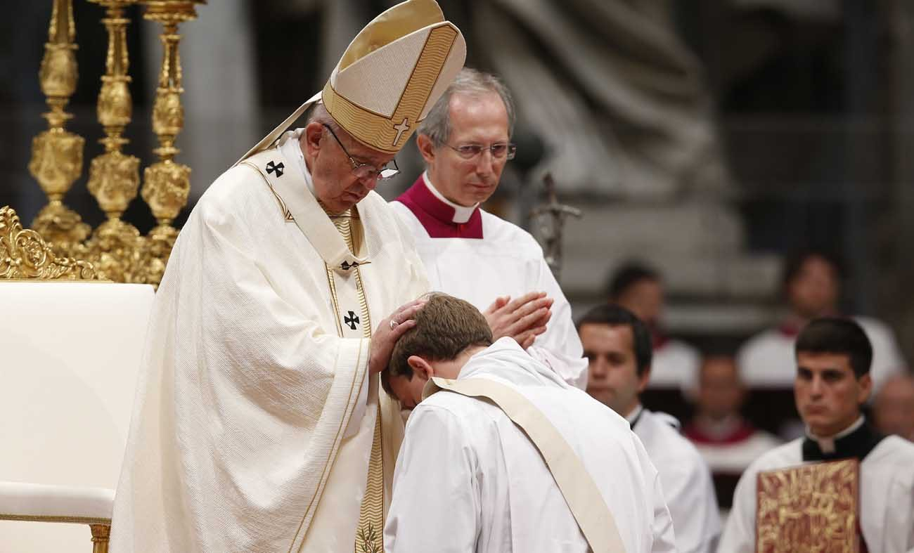 Pope Francis ordains one of 10 new priests for the Diocese of Rome during an ordination Mass in St. Peter's Basilica at the Vatican May 7. (CNS photo/Paul Haring)
