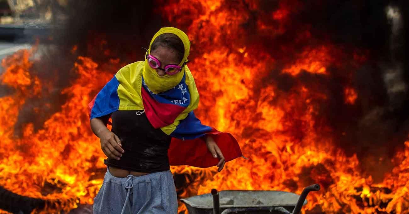 A woman is seen during a demonstration against the Venezuelan government in Caracas, Venezuela, April 24. (CNS photo/Miguel Gutierrez, EPA)