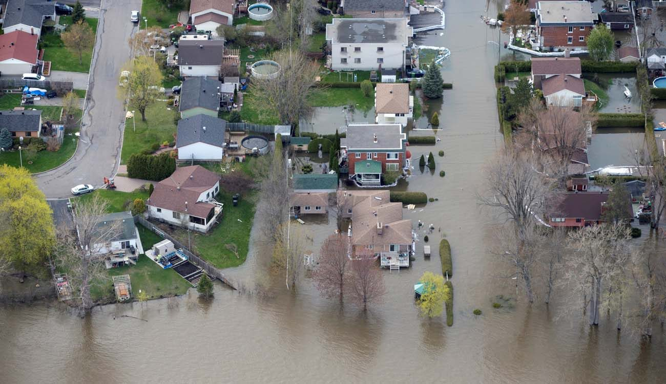 An overhead view taken May 8 shows the flooded residential neighborhood in Ile Bizard, Quebec. A mix of heavy rains and melting snow caused the situation. (CNS photo/Christinne Muschi, Reuters)
