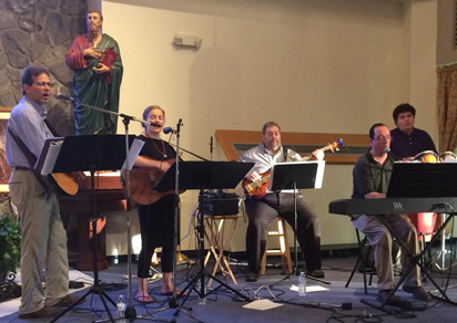 The band Spreading the Flame provides music during the Mass and healing service May 19 at St. Thomas the Apostle Church, Glen Mills.