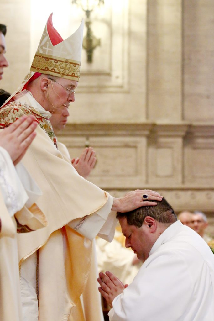 Brandon Artman is ordained a transitional deacon by Bishop Timothy Senior.