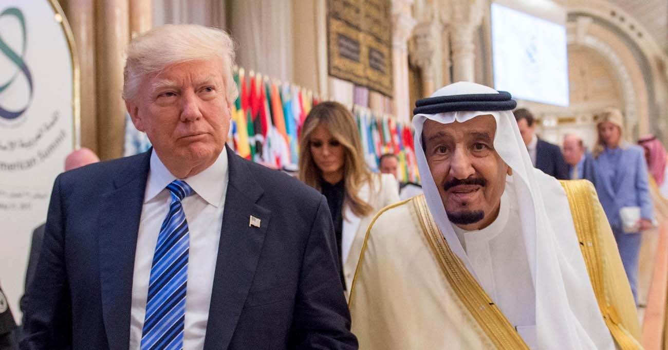 U.S. President Donald Trump walks with Saudi King Salman during the opening session of the Gulf Cooperation Council summit May 21 in Riyadh, Saudi Arabia. (CNS photo/Saudi Press Agency via EPA)