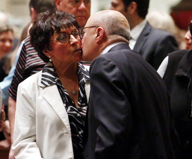 Brenda and Ed Lewis, married 25 years, offer one another a kiss as a sign of peace.